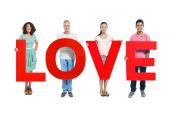 People holding 'LOVE' red letters — Stock Photo