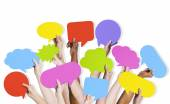 Arms Raised with Speech Bubbles — Stock Photo