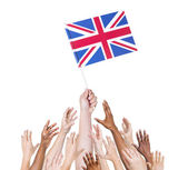 Hand holding Great Britain flag — Stock Photo