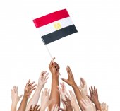 Multi-ethnic people holding flag of Egypt — Stock Photo