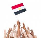 Multi-ethnic people holding flag of Egypt — Stock Photo