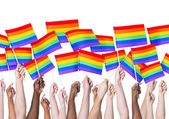People's hands holding LGBT Flags — Stock Photo