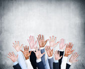 Human Arms Raised with Concrete Wall — Stock Photo