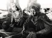 Women repairing fishing nets — Stock Photo