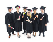 Groip of Cheerful and Succesful Graduating Students — Stock Photo