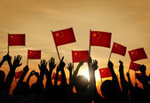 People Waving Chinese Flags — Stock Photo