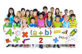 Diverse Cheerful Children Holding Mathematical Symbols — Stock Photo