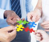 Business people connecting jigsaw together — Stock Photo