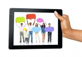 People on tablet screen — Stock Photo
