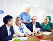 Group Of General Practitioners Having Meeting — Stock Photo