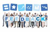 People holding word feedback — Stock Photo