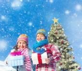 Children enjoying their christmas presents — Stock Photo