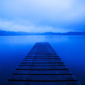 Tranquil peaceful lake with jetty — Stock Photo