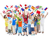 Eople celebrating while holding flags — Foto Stock