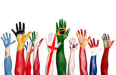 Flags Drawn on Raised Hands — Stockfoto