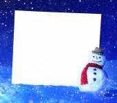 Snowman with with placard — Stock Photo