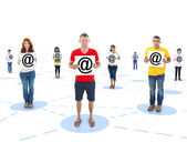 Connected Multi-Ethnic People Holding the Symbol of At — Stock Photo