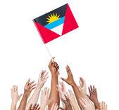Arms Raised for Flag of Antigua and Barbuda — Stock Photo