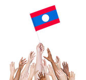 People holding flag of Laos — Stock Photo