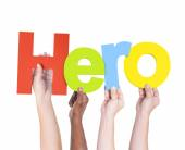People's Arms Holding Letters hero — Stock Photo