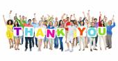 People holding cardboards forming thank you — Stock Photo