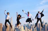 Business people jumping in New York — Zdjęcie stockowe