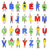Group of people holding the Letters A-Z — Stock Photo