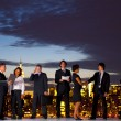 Business people working through dawn — Stock Photo #52469417
