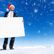 Businessman holding blank placard — Stock Photo #52460975