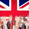 Multi-Ethnic Arms Outstretched With British Flag — Stock Photo #52461177