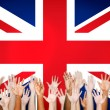 Multi-Ethnic Arms Outstretched With British Flag — Stock Photo #52462405