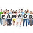 People Holding Letters Form Teamwork — Stockfoto #52463569