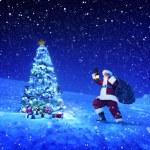 Santa claus holding lantern and sack — Stock Photo #52463603