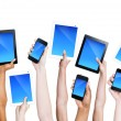Hands holding smartphones and tablets — Stock Photo #52464055