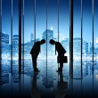Two Businessmen Bowing To Each Other In An Office Building — Stock Photo #52465175