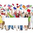 People holding flags and white placard — Stock Photo #52465209