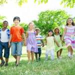 Children walking In Park — Stock Photo #52465243