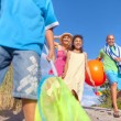 Cheerful Family Going to the Beach — Stock Photo #52465901