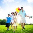 Family walking towards camera — Stock Photo #52468945