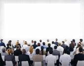 Group Of Business People Sitting And Looking At The Blank Presen — Stock Photo