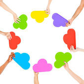 Hands holding cloud shaped speech bubbles — Stock Photo