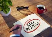 Businessman Writing 'Stay Positive' — Stockfoto