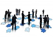 Group Of Business People Working And Standing On Jigsaw Puzzles — Stock Photo