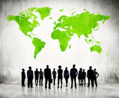 Business People And Green Cartography Of World — Stock Photo
