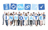 People holding word innovate — Stock Photo