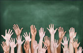 Hands Raised with Blackboard — Stock Photo