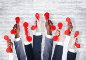Business people holding red phones — Stock Photo