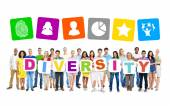 People holding letters forming diversity — Stock Photo