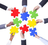 Hands of Business Teamwork holding puzzles — Stock Photo