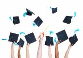 Graduating Student's Hands Throwing hats — Stock Photo